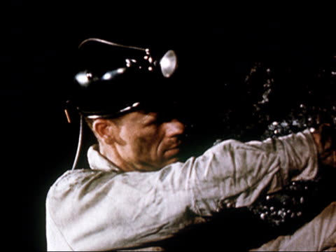 1949 close up coal miner with lighted helmet working in mine/ audio - 1949 stock-videos und b-roll-filmmaterial