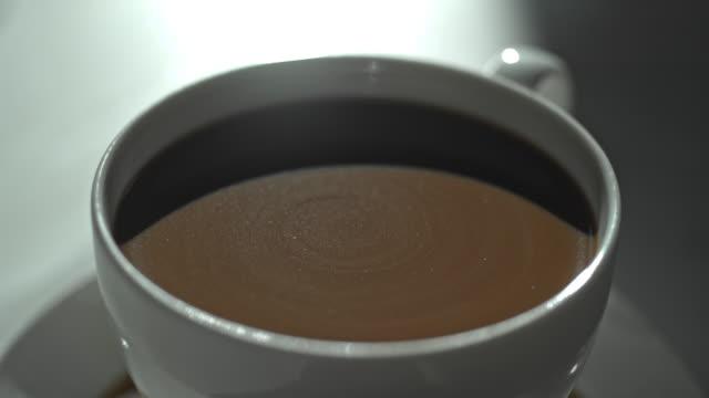 close up coffee cup swirl milk creamer macro - jug stock videos & royalty-free footage
