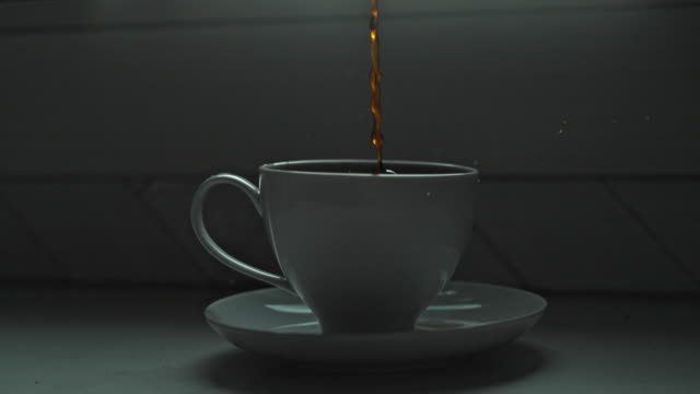 close up coffee drops slow motion pour - coffee cup stock videos & royalty-free footage