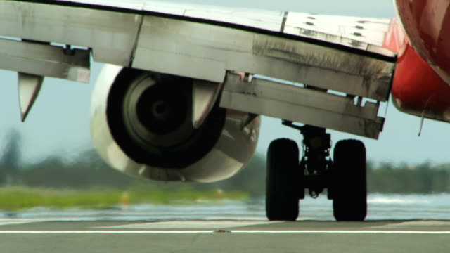 Close up commercial airplane turns at the end of runway