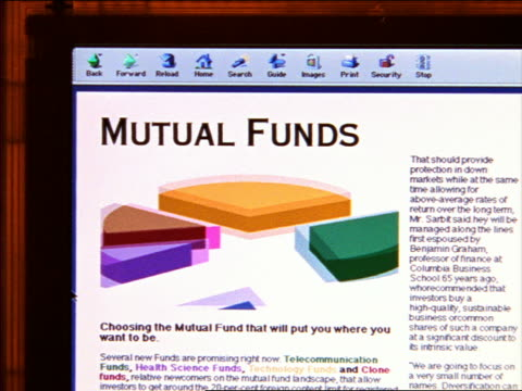 close up computer display of mutual funds screen with animated pie