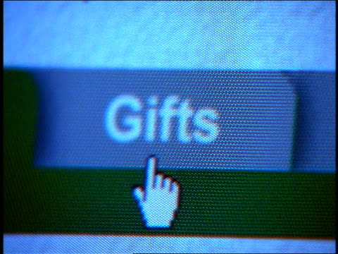 """close up computer display with pointer selecting """"Gifts"""" tab"""