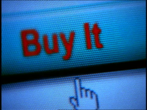 "close up computer display with pointer selecting + pushing ""Buy It"" button"