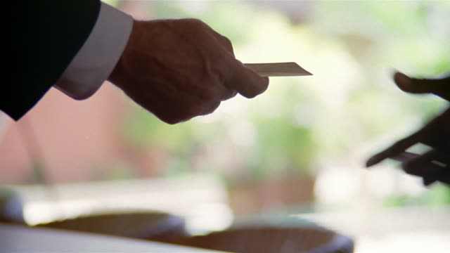 close up concierge handing man key card  and turning around registration book - checkout stock videos and b-roll footage