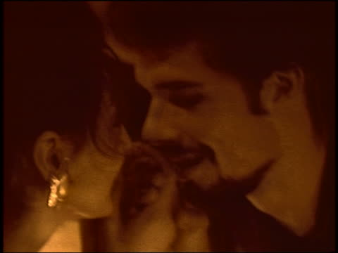 stockvideo's en b-roll-footage met close up couple holding hands + kissing in restaurant / france - heteroseksueel koppel