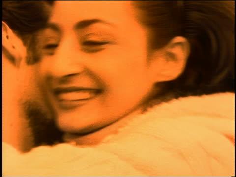 close up couple hugging, kissing + smiling / Paris