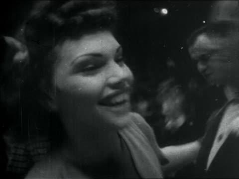 b/w 1938 close up couple swing dancing + clarinetists playing (2 shots) / documentary - mindre än 10 sekunder bildbanksvideor och videomaterial från bakom kulisserna