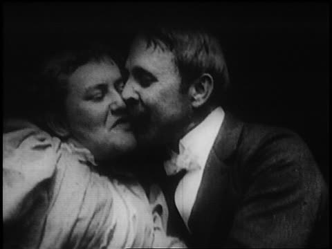 b/w 1895 close up couple talking, kissing + cuddling (first screen kiss) / short film - romance stock videos & royalty-free footage