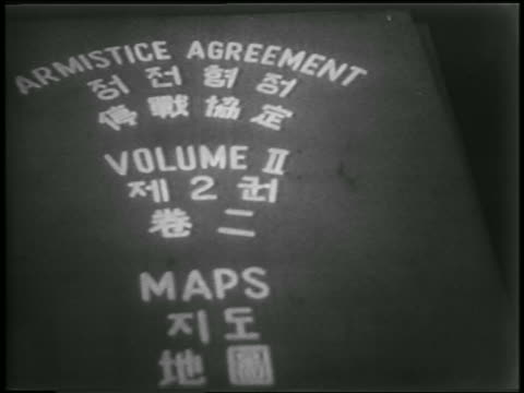 b/w 1953 close up cover of korean war armistice agreement / newsreel - korean war stock videos & royalty-free footage