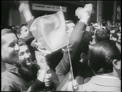 b/w 1955 close up crowd cheering waving flags after overthrowing of juan peron / buenos aires / newsreel - coup d'état stock videos & royalty-free footage