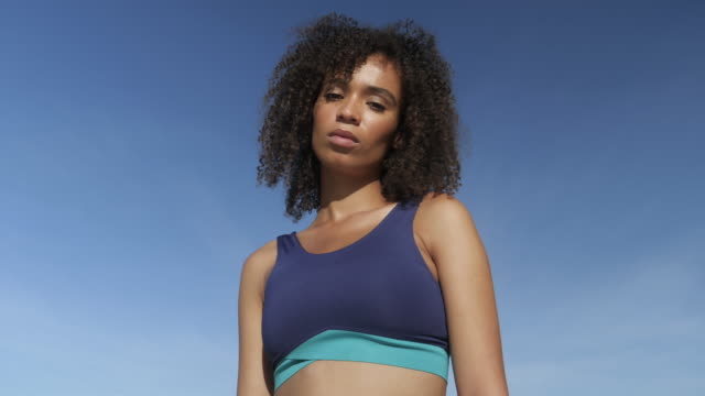 close up, curly haired woman wearing sports bra - sports bra stock videos & royalty-free footage