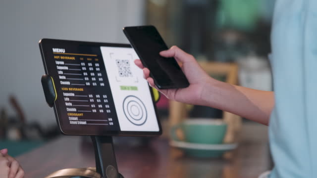close up customer use mobile phone pay contactless with tablet at counter bar in cafe.small business start up.customer service concept - using digital tablet stock videos & royalty-free footage