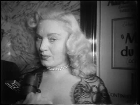 "vídeos de stock, filmes e b-roll de close up dagmar being interviewed at ""meet danny wilson"" premiere / newsreel - 1951"