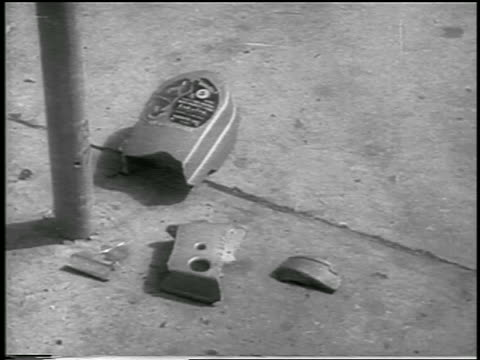 b/w 1959 close up destroyed parking meter on ground after revolution / havana / newsreel - 1959 stock videos & royalty-free footage