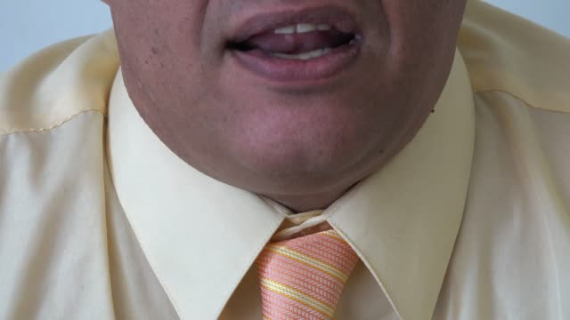 Close up detail of a man mouth moving while he talks
