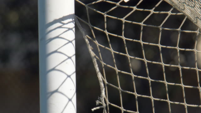 close up detail of a soccer goal and net football on a turf grass field. - netting stock videos & royalty-free footage