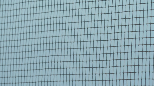 close up detail of a volleyball net netting on a court. - slow motion - volleyball net stock videos & royalty-free footage