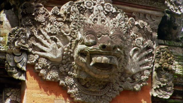 Close up detail of carving on Pura Dalem Agung Temple near Ubud Monkey Forest Sanctuary / Bali, Indonesia