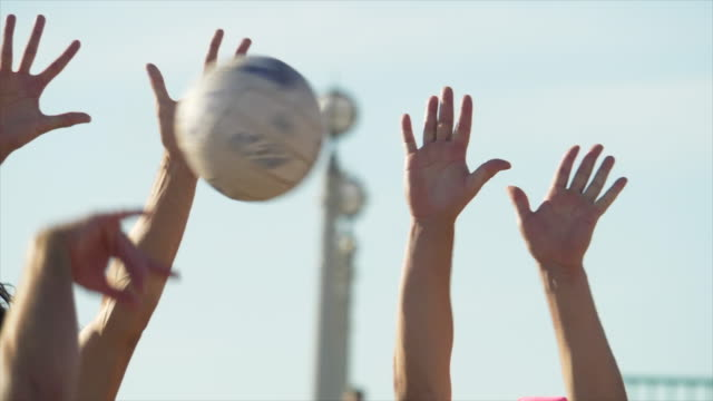 close up details of men playing beach volleyball in the sand, six-man. - slow motion - volleyballnetz stock-videos und b-roll-filmmaterial