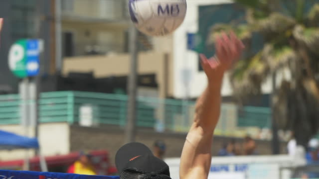 close up details of men playing beach volleyball in the sand, six-man. - slow motion - volleyball sport stock videos & royalty-free footage