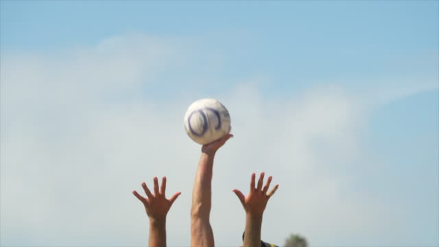 close up details of men playing beach volleyball in the sand, six-man. - slow motion - game show bildbanksvideor och videomaterial från bakom kulisserna