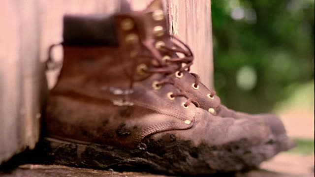 Close up dirty boots on deck outdoors / Clarksville, Iowa