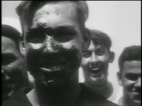 vídeos de stock, filmes e b-roll de b/w 1928 close up dirty face of sailor after pie eating contest on ship / nyc / newsreel - contestant
