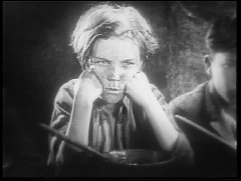 vidéos et rushes de b/w 1922 close up dirty orphan boy with freckles looking angry / feature - orphelin