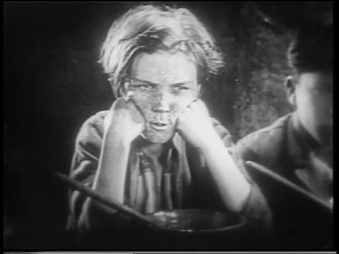vidéos et rushes de b/w 1922 close up dirty orphan boy with freckles pouting / feature - orphelin
