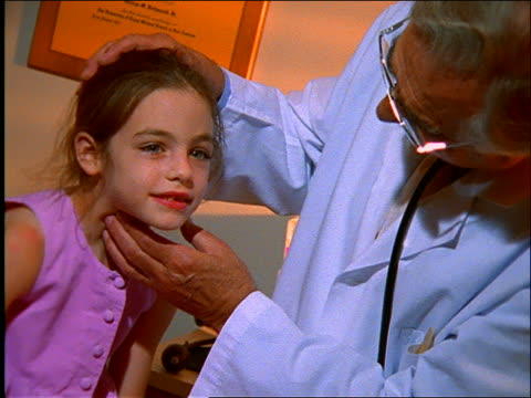 close up doctor examining young girl in his office - patientin stock-videos und b-roll-filmmaterial