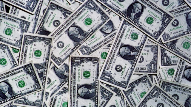 close up dollar bills piling up - american one dollar bill stock videos & royalty-free footage