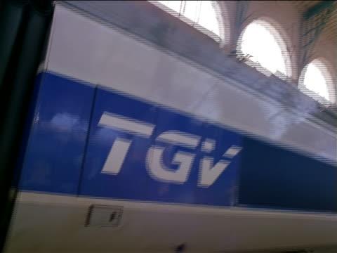"close up dolly shot around ""TGV"" logo on train in Gare de Lyon / Paris, France"
