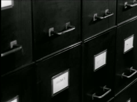 b/w 1947 close up dolly shot file cabinets / industrial - filing cabinet stock videos and b-roll footage