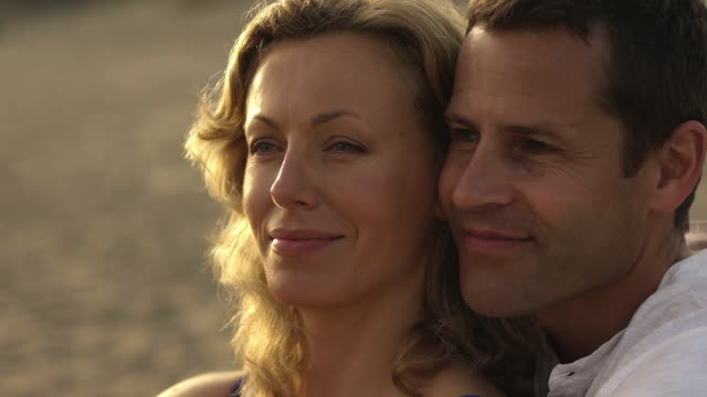 close up dolly shot of couple embracing on beach/marbella region, spain - dolly shot stock videos & royalty-free footage