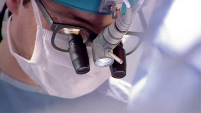 close up dolly shot surgeon performing operation - 30 39 years stock videos & royalty-free footage