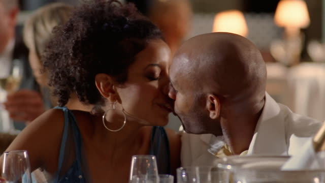 vidéos et rushes de close up dolly shot young wealthy couple drinking champagne / man giving woman ring - cadeau