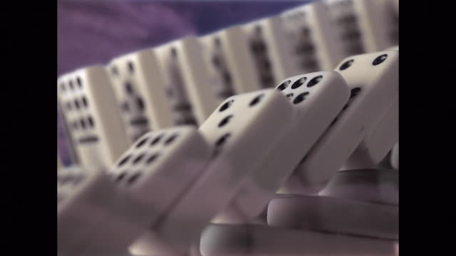 close up dominoes falling - dominoes stock videos & royalty-free footage