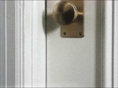 """1985 close up door opening and hand placing """"do not disturb"""" sign on knob before closing it again"" - 1985 stock videos & royalty-free footage"