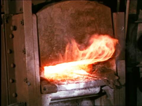 vídeos y material grabado en eventos de stock de 1946 close up door opening on large furnace in factory / industrial - 1946