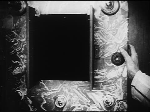 b/w 1916 rear view close up douglas fairbanks sr. talking to policeman (tom wilson) over videophone - 1910 stock videos & royalty-free footage