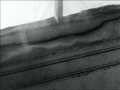 vidéos et rushes de b/w 1936 close up dust blowing over structure in storm / dust bowl / usa - 1936
