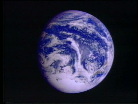1980 CGI close up Earth spinning in space / documentary