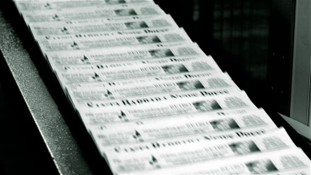 close up edition of santa barbara news times coming out of printing press on conveyer belt / santa barbara, california - pressa da stampa video stock e b–roll
