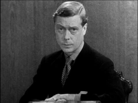 vídeos y material grabado en eventos de stock de b/w 1936 close up edward viii sitting at desk giving radio address announcing abdication of throne - 1936