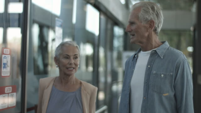 stockvideo's en b-roll-footage met close up, elderly couple in bus station - anticipation