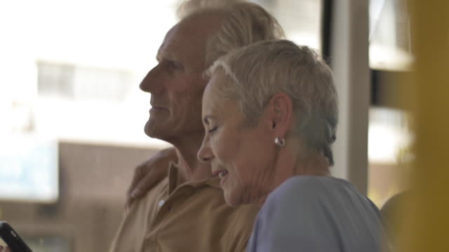 stockvideo's en b-roll-footage met close up, elderly couple on bus - moving image