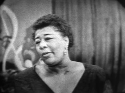 b/w 1955 close up ella fitzgerald singing between the devil deep blue sea / the larry finley show - ella fitzgerald stock videos & royalty-free footage