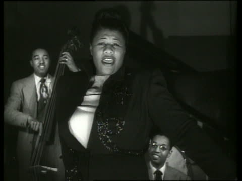 b/w close up ella fitzgerald singing with musicians in background - ella fitzgerald stock videos & royalty-free footage