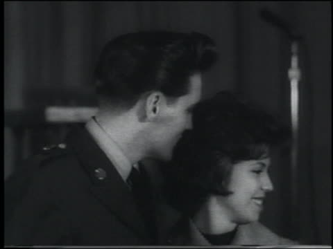 newsreel close up elvis presley in his army uniform standing with nancy sinatra - nancy sinatra stock videos and b-roll footage