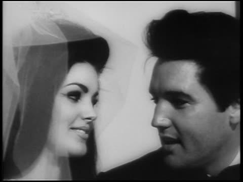 close up elvis + priscilla looking at each other + talking after wedding / las vegas / newsreel - プリシラ プレスリー点の映像素材/bロール